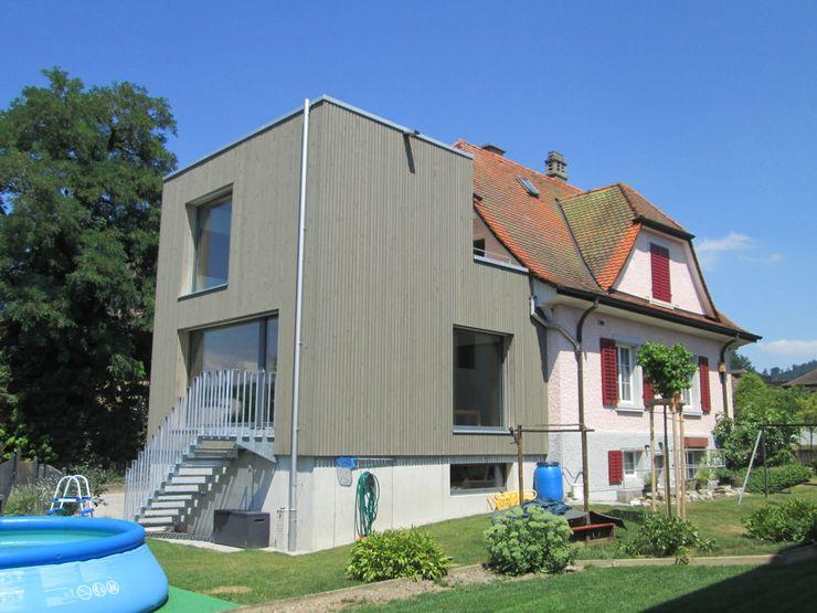 Brauen & Partner Architektur GmbH Modern houses Wood Grey