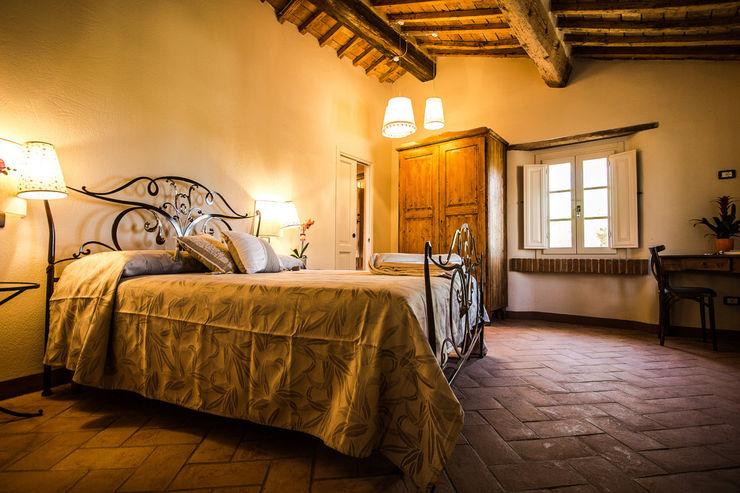 Studio Luppichini Rustic style bedroom