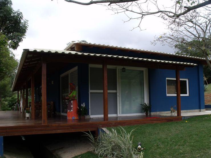 Cristiane Locatelli Arquitetos & Associados Casas rústicas