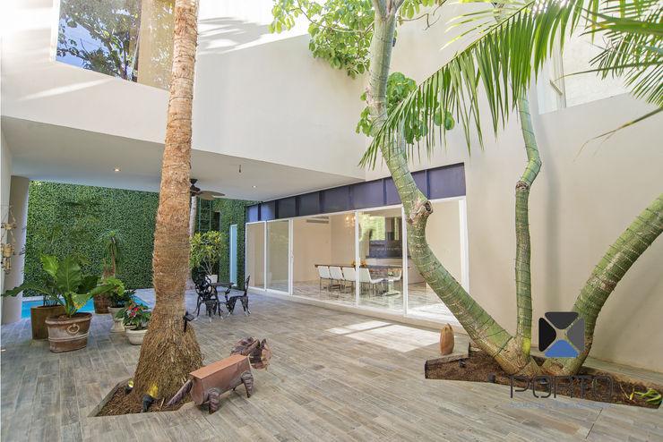 """Proyecto Residencial """"La Ramona."""" PORTO Arquitectura + Diseño de Interiores Jardines eclécticos"""