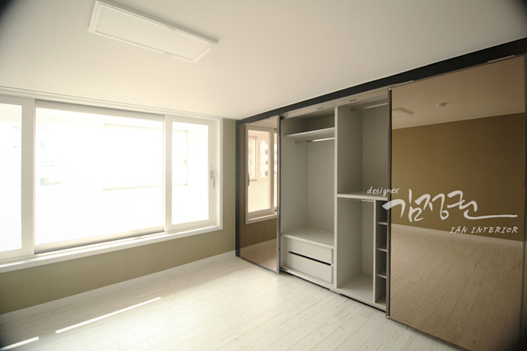 김정권디자이너 Dormitorios modernos: Ideas, imágenes y decoración Tablero DM Gris