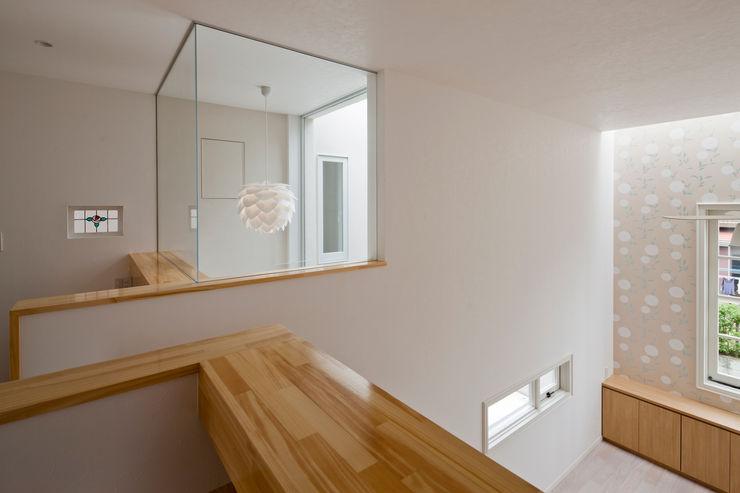 ハーレーのある住宅 TTAA/ 高木達之建築設計事務所 モダンデザインの 多目的室