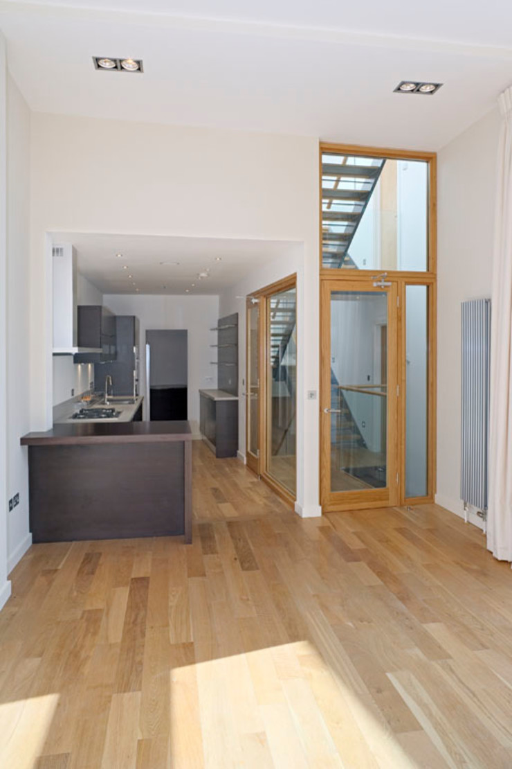 Kitchen and stairs The Chase Architecture Moderne Küchen Holz Grau