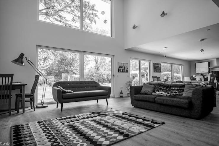 Double height living room The Chase Architecture Living room Leather