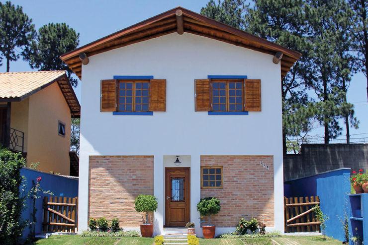 RAC ARQUITETURA Casas de estilo rústico Ladrillos Blanco