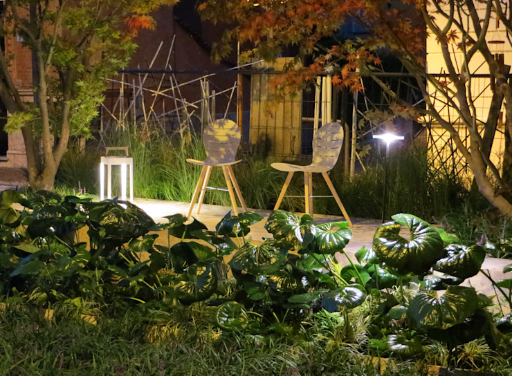Farfugliando fra Farfugium. Allestimento per Trifolia - Arona . MASSIMO SEMOLA PROGETTAZIONE GIARDINI MILANO Giardino minimalista