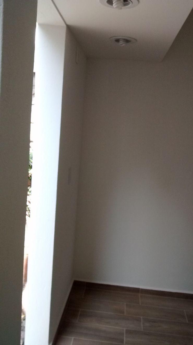 Rehabilitación de cuarto de servicio Fixing Paredes y pisos de estilo ecléctico Ladrillos Blanco