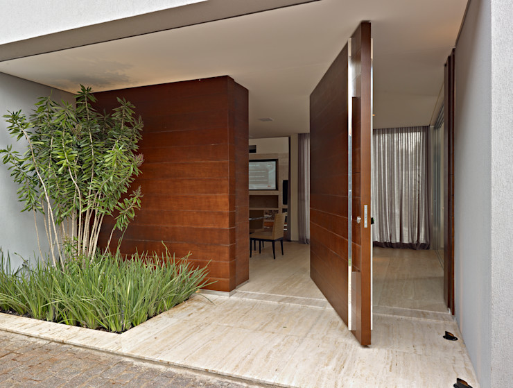 Márcia Carvalhaes Arquitetura LTDA. Modern houses