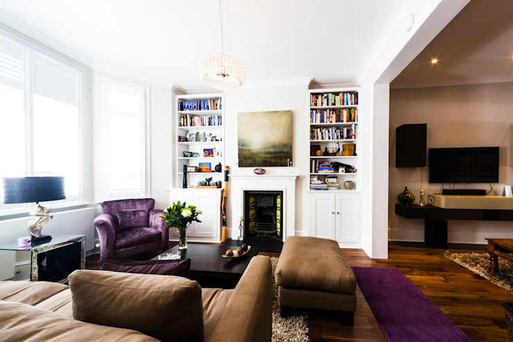 White Living Room with wooden floors, brown sofa, carpet and purple accents Affleck Property Services غرفة المعيشة Purple/Violet