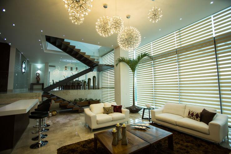 Vista de sala y comedor. Dovela Interiorismo Salones de estilo moderno