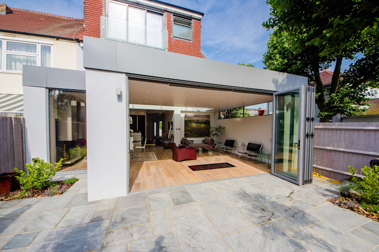 HOUSE EXTENSION & LOFT CONVERSION IN SW LONDON DPS ltd. Jardin d'hiver moderne