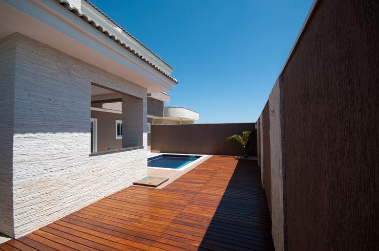 Angelica Pecego Arquitetura オリジナルスタイルの プール