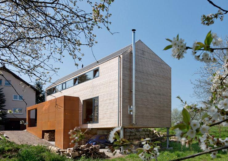Cherry Blossom House (German Passivhaus) ÜberRaum Architects Modern balcony, veranda & terrace