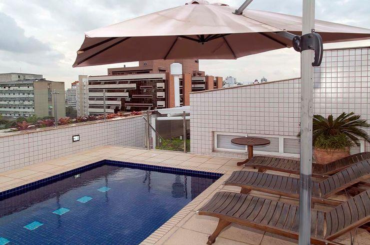 Piscina homify Varandas, marquises e terraços modernos
