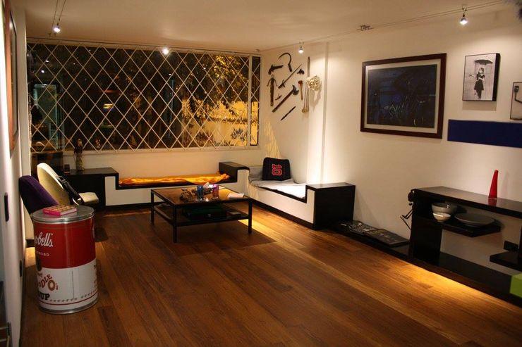 Apartamento Daniel Anzola Heritage Design Group Salas modernas
