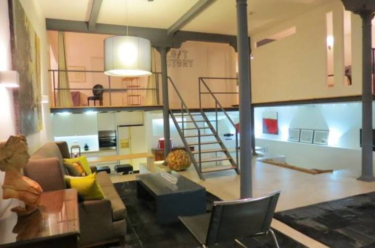 Loft Story DRCF Arquitectos Salas de estar industriais