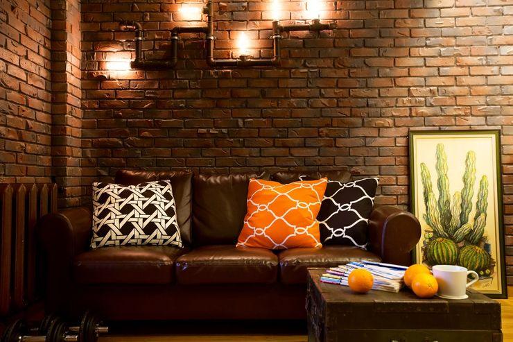 homify Industrial style walls & floors Bricks Brown