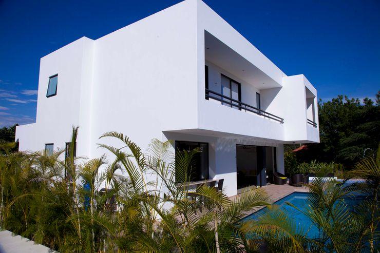 homify Moderne Häuser Ziegel Weiß