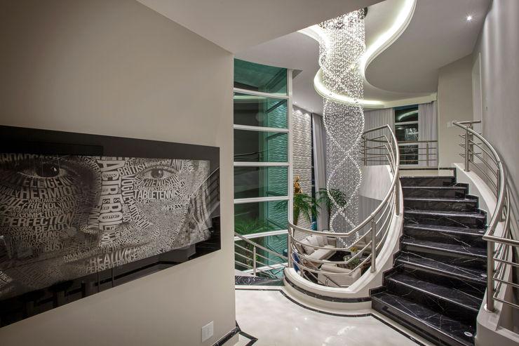 homify Corredores, halls e escadas modernos Mármore Preto