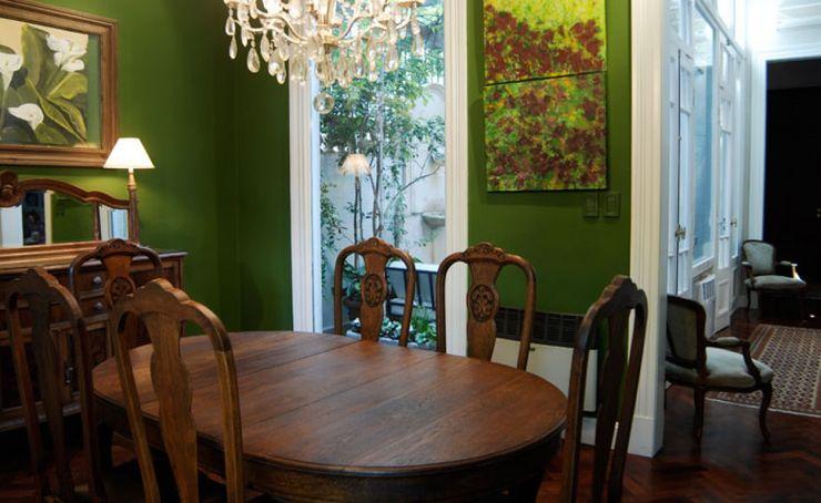 Sala comedor. Radrizzani Rioja Arquitectos Comedores de estilo ecléctico Hormigón Verde