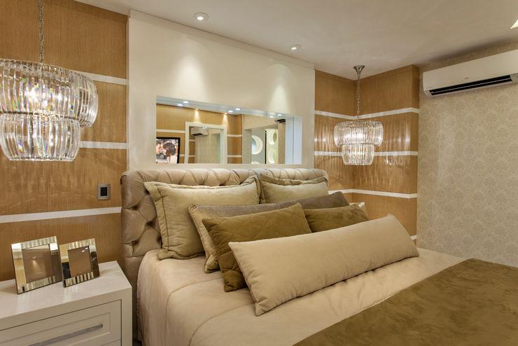 Designer de Interiores e Paisagista Iara Kílaris Dormitorios modernos Beige