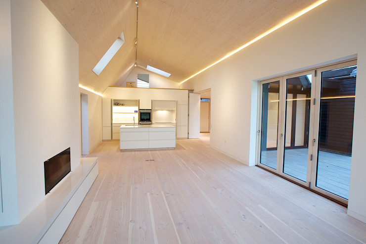 The open plan kitchen and living room at the Bourne Lane Eco House. Nash Baker Architects Ltd Modern Living Room White