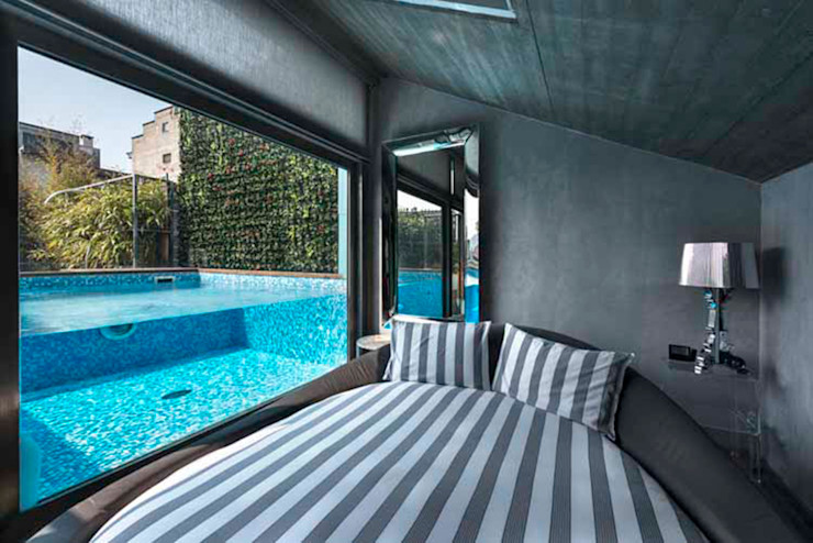 Loft in Torino Lana_Savettiere Architetti Camera da letto minimalista