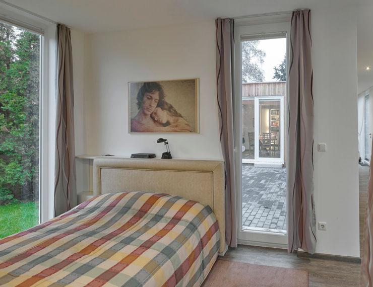 +studio moeve architekten bda Minimalist bedroom