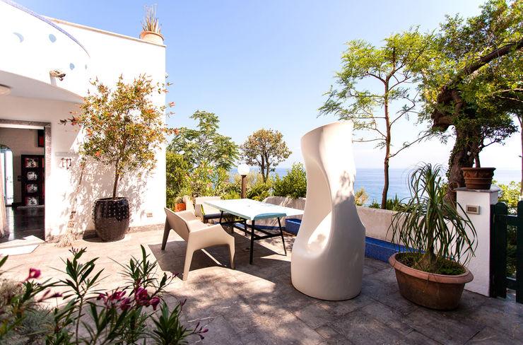 Terraza Carmé Balcones y terrazas de estilo ecléctico
