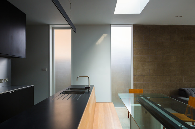 View across kitchen island and built in bench Mustard Architects Industrial style kitchen