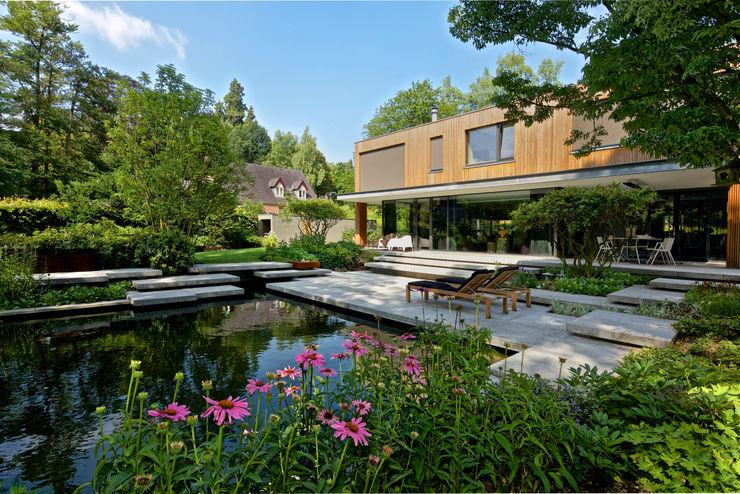 Jaap Sterk Hoveniers Jardines de estilo moderno Hormigón Gris