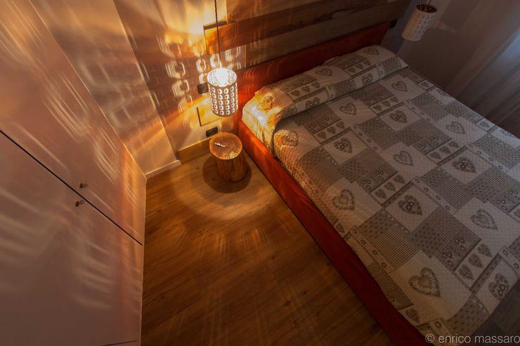 enrico massaro architetto BedroomLighting Iron/Steel Amber/Gold