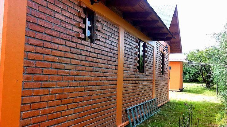 OMR ARQUITECTURA & DISEÑO DE INTERIORES Rustic style windows & doors