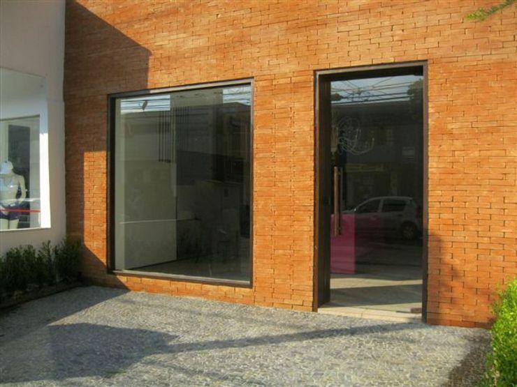 Lucia Helena Bellini arquitetura e interiores Будинки