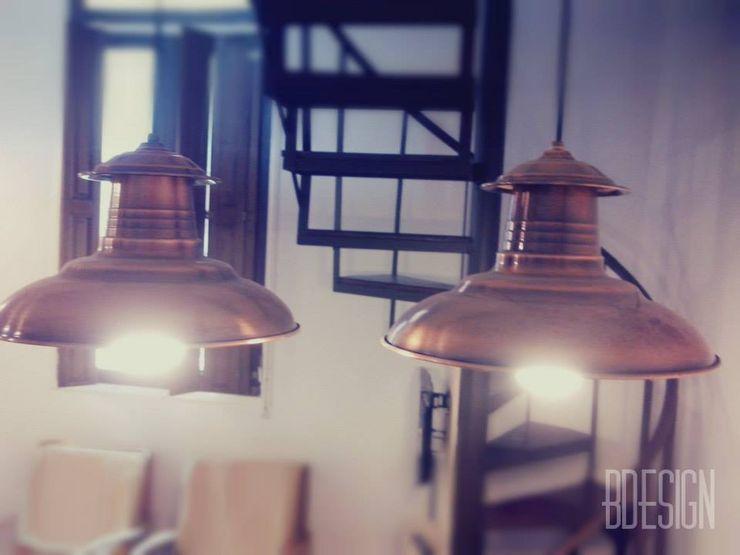 Estudio BDesign Industrial style dining room Iron/Steel Amber/Gold