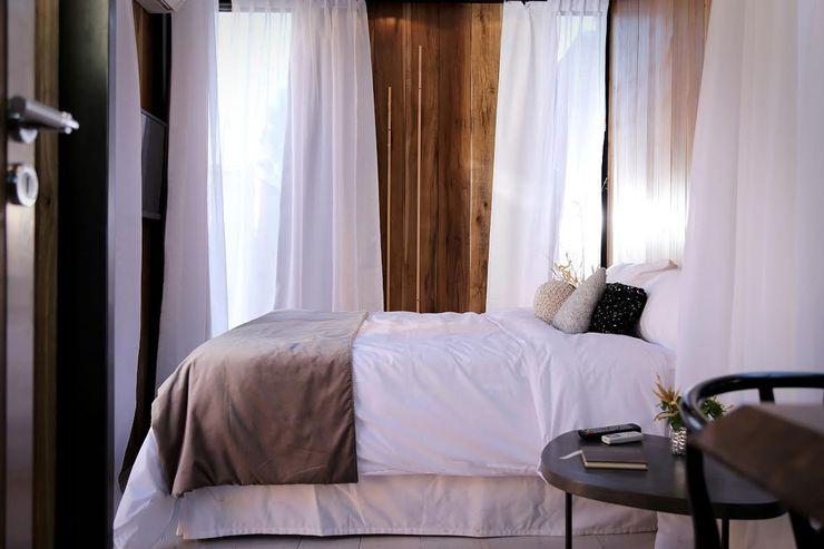 Proyecto Nomad T + T Arquitectos Dormitorios modernos: Ideas, imágenes y decoración