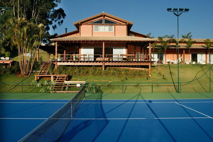 Casa Fazenda CC Silvia Cabrino Arquitetura e Interiores Casas rústicas