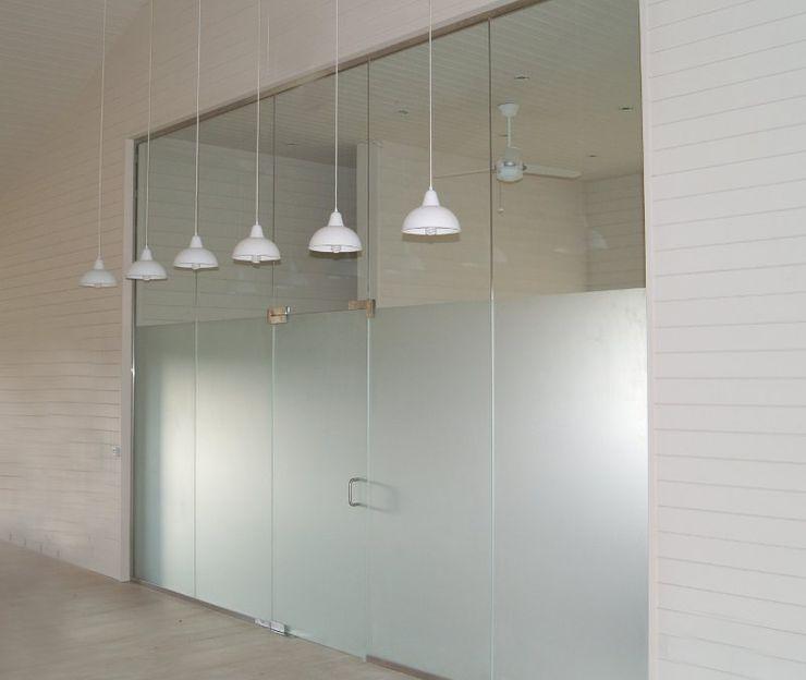 Sandblasted glass doors in glass screen Ion Glass Modern walls & floors Glass
