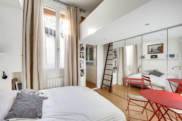 Shoootin pour Nelson Architecture Intérieur & Design Shoootin BedroomBeds & headboards