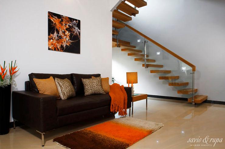 Cantilevered Staircase Savio and Rupa Interior Concepts Modern corridor, hallway & stairs
