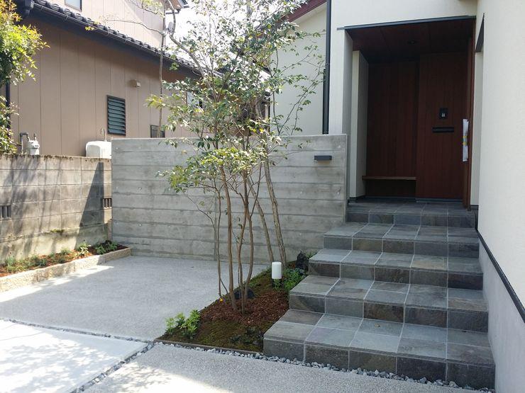 株式会社 砂土居造園/SUNADOI LANDSCAPE Casas modernas Madera Negro