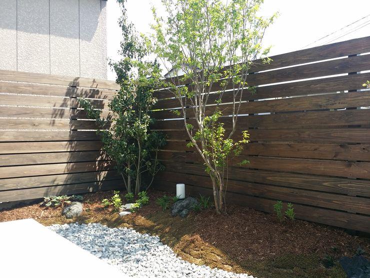 株式会社 砂土居造園/SUNADOI LANDSCAPE Modern Garden Stone Wood effect