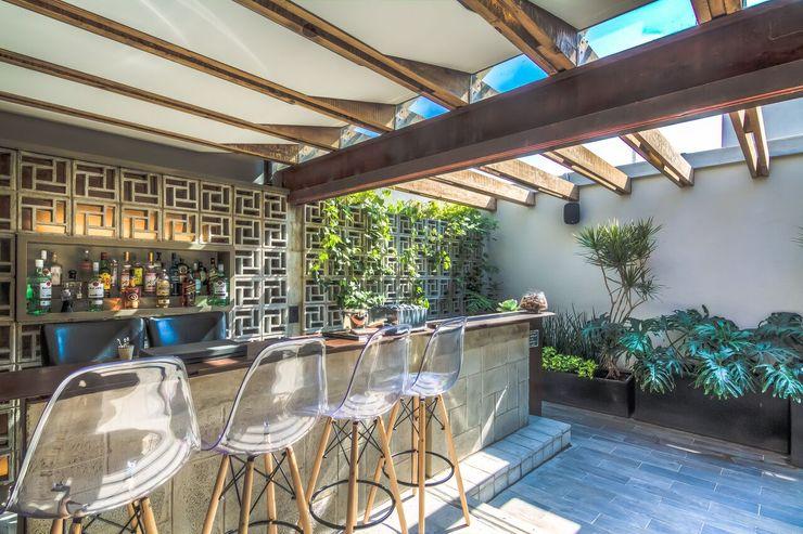 homify Industrial style balcony, veranda & terrace