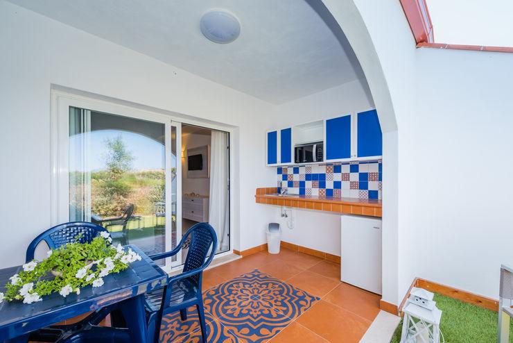 Portico con terrazza Angelo De Leo Photographer Balcone, Veranda & Terrazza in stile moderno