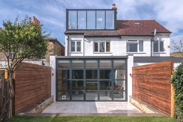 East Dulwich 1 Proctor & Co. Architecture Ltd Casas modernas: Ideas, imágenes y decoración Vidrio Negro