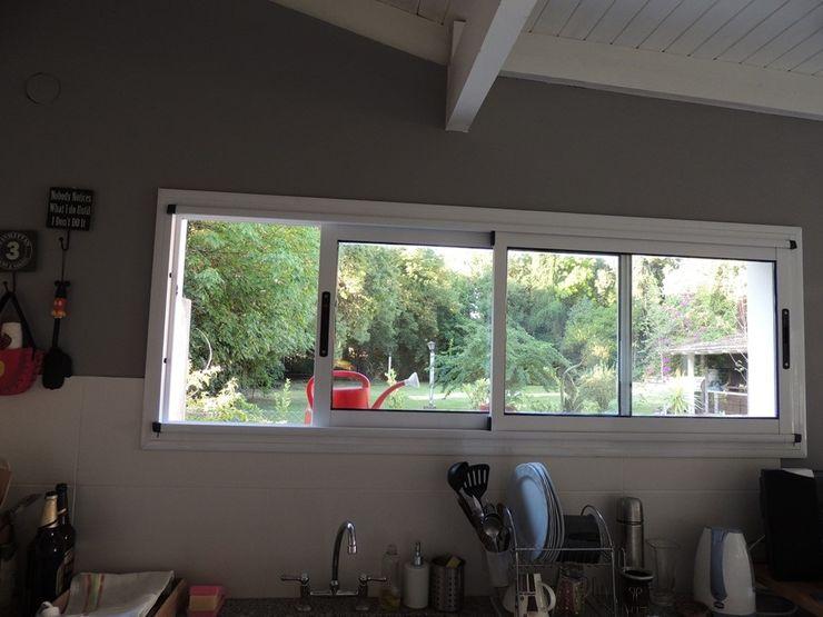 cocina luego de la remodelacion Estudio ZP Cocinas modernas: Ideas, imágenes y decoración Granito Blanco