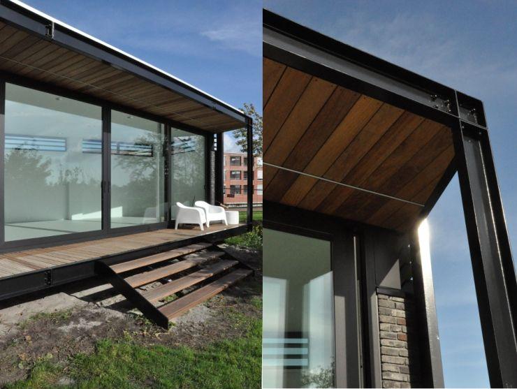 Uitbreiding villa te Sneek AV Architectuur Moderne balkons, veranda's en terrassen IJzer / Staal Zwart