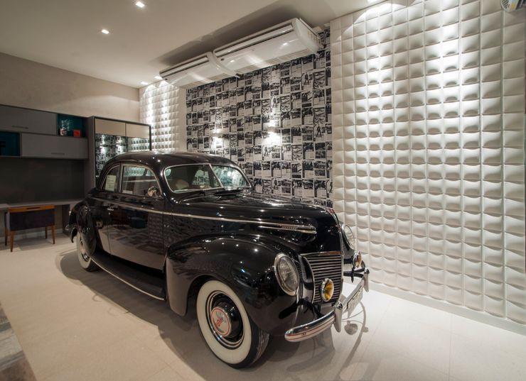 Garagem com lounge Carolina Mota - Arquitetura, Interiores e Iluminação Garagens e edículas modernas