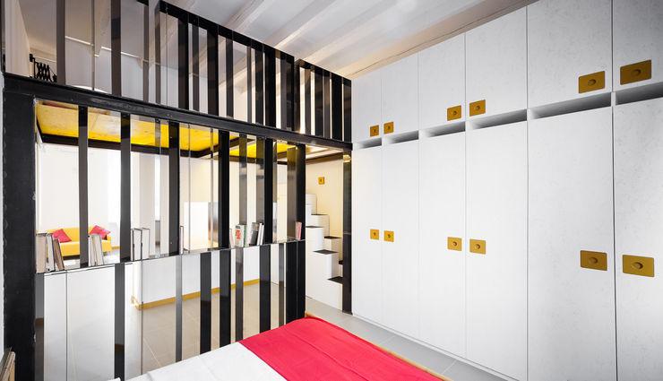 camera da letto 23bassi studio di architettura Camera da letto eclettica Giallo