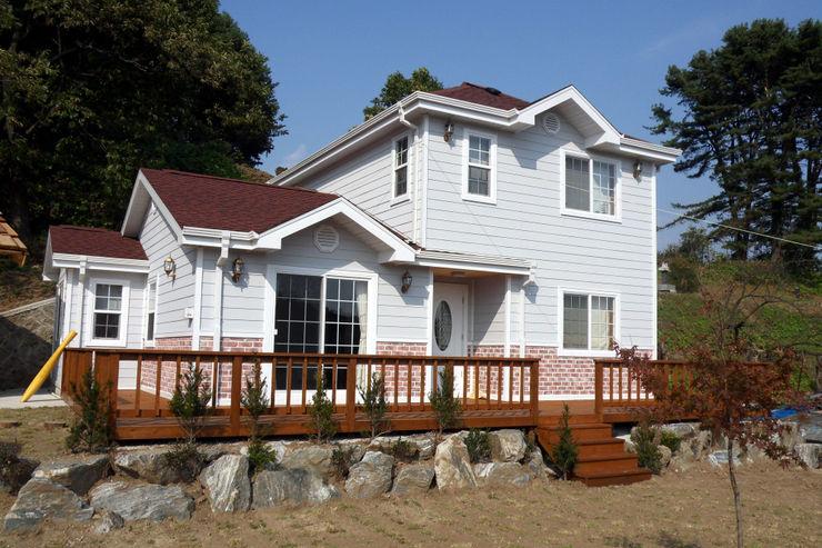 팀버하우스 2 homify Classic style houses